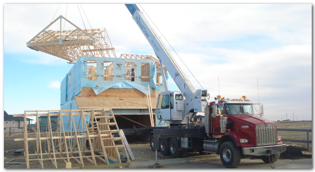 crane lifting house frame